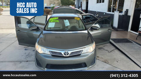 2012 Toyota Camry for sale at HCC AUTO SALES INC in Sarasota FL