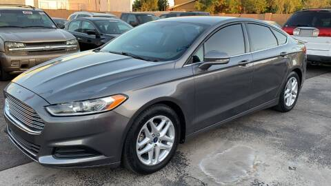 2014 Ford Fusion for sale at 911 AUTO SALES LLC in Glendale AZ