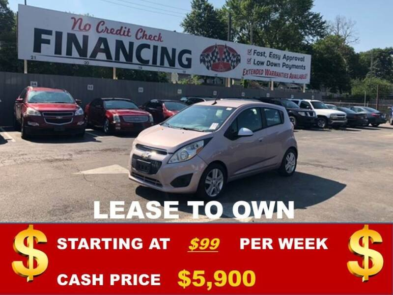 2013 Chevrolet Spark for sale at Auto Mart USA in Kansas City MO