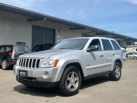2006 Jeep Grand Cherokee for sale at DASH AUTO SALES LLC in Salem OR