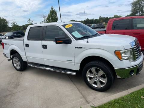 2011 Ford F-150 for sale at Azteca Auto Sales LLC in Des Moines IA