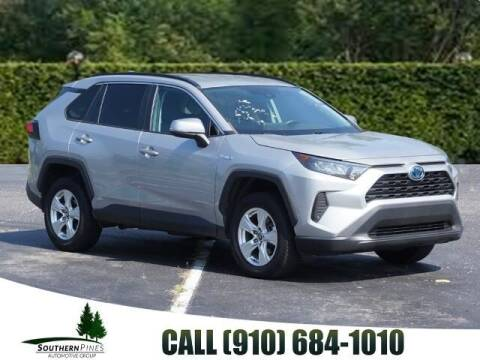 2019 Toyota RAV4 Hybrid for sale at PHIL SMITH AUTOMOTIVE GROUP - Pinehurst Nissan Kia in Southern Pines NC