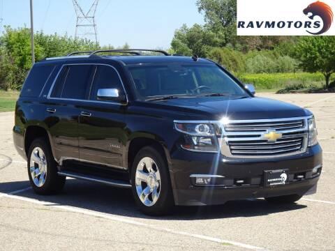 2015 Chevrolet Tahoe for sale at RAVMOTORS in Burnsville MN
