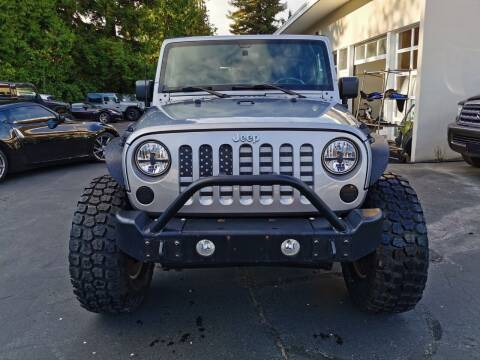 2013 Jeep Wrangler for sale at Legacy Auto Sales LLC in Seattle WA