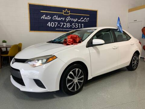 2014 Toyota Corolla for sale at Auto Chars Group LLC in Orlando FL