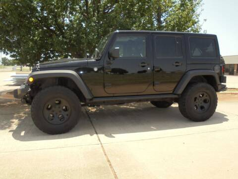 2013 Jeep Wrangler Unlimited for sale at MANGUM AUTO SALES in Duncan OK