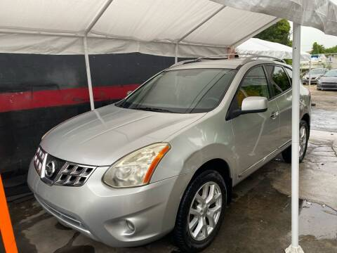 2013 Nissan Rogue for sale at Velocity Autos in Winter Park FL