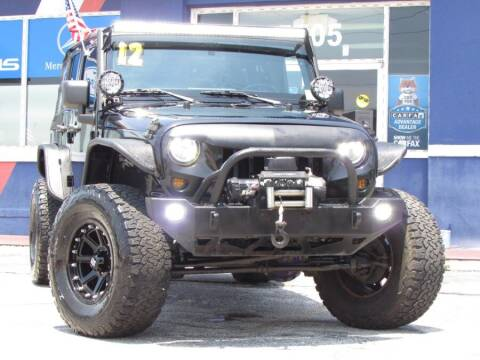 2012 Jeep Wrangler Unlimited for sale at VIP AUTO ENTERPRISE INC. in Orlando FL