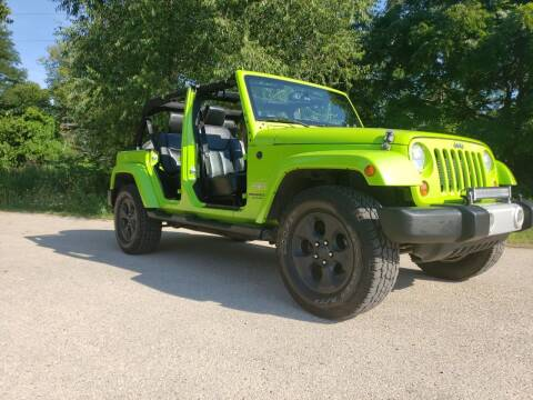 2013 Jeep Wrangler Unlimited for sale at Super Trooper Motors in Madison WI