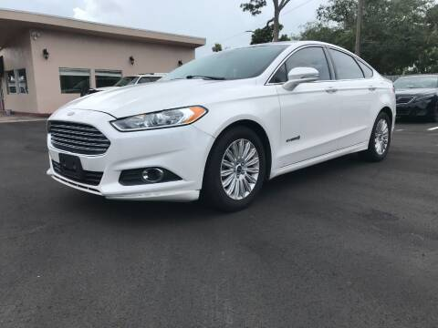 2014 Ford Fusion Hybrid for sale at AutoVenture in Holly Hill FL