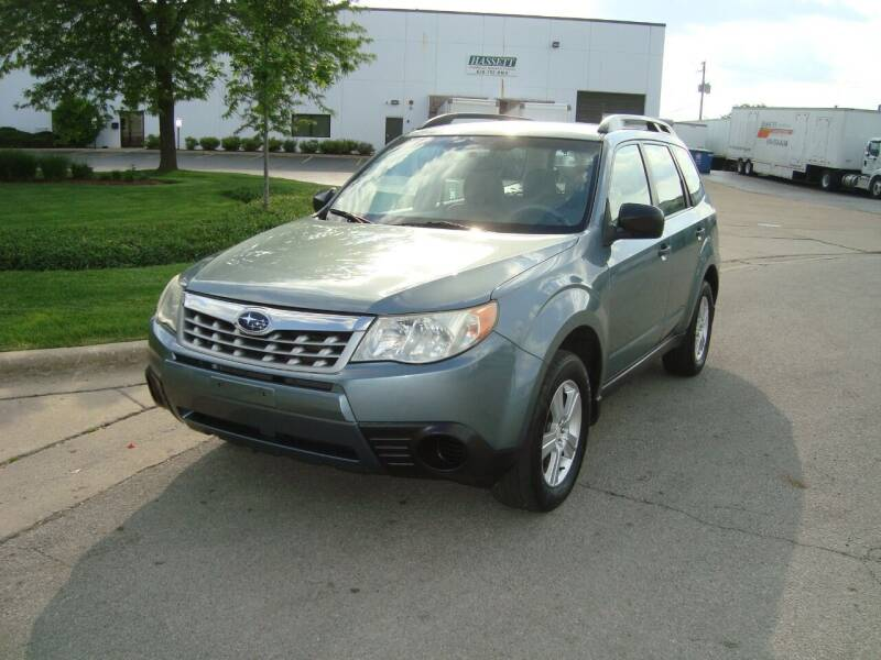 2012 Subaru Forester for sale at ARIANA MOTORS INC in Addison IL