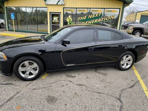 2012 Dodge Charger for sale at RPM AUTO SALES in Lansing MI