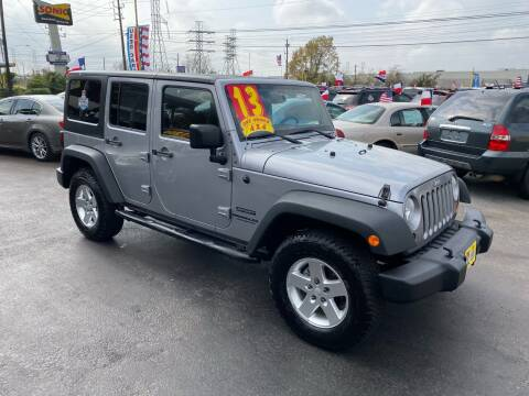 2013 Jeep Wrangler Unlimited for sale at Texas 1 Auto Finance in Kemah TX
