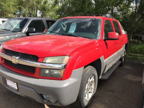 2002 Chevrolet Avalanche for sale at BARNES AUTO SALES in Mandan ND