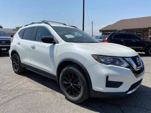 2017 Nissan Rogue for sale at BERKENKOTTER MOTORS in Brighton CO