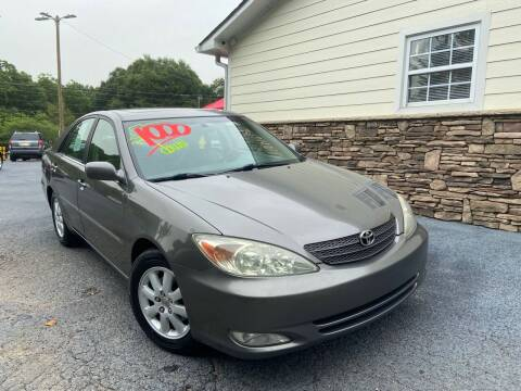 2004 Toyota Camry for sale at No Full Coverage Auto Sales in Austell GA