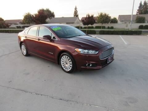 2016 Ford Fusion Hybrid for sale at Repeat Auto Sales Inc. in Manteca CA