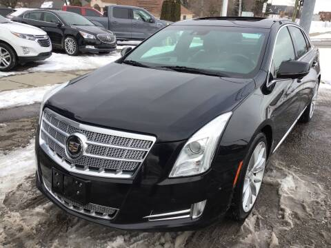 2014 Cadillac XTS for sale at One Price Auto in Mount Clemens MI