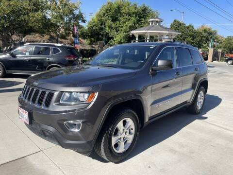 2014 Jeep Grand Cherokee for sale at Los Compadres Auto Sales in Riverside CA