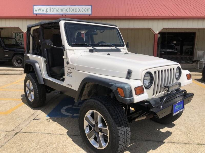 1999 Jeep Wrangler for sale at PITTMAN MOTOR CO in Lindale TX