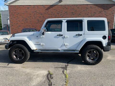 2012 Jeep Wrangler Unlimited for sale at BAY CITY MOTORS in Portland ME