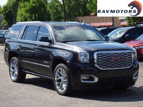 2018 GMC Yukon for sale at RAVMOTORS in Burnsville MN