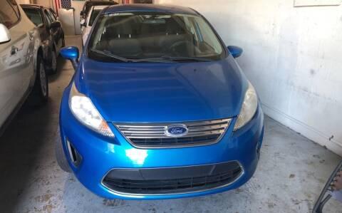 2012 Ford Fiesta for sale at Auto Credit & Finance Corp. in Miami FL
