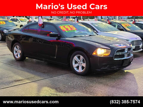 2014 Dodge Charger for sale at Mario's Used Cars in Houston TX