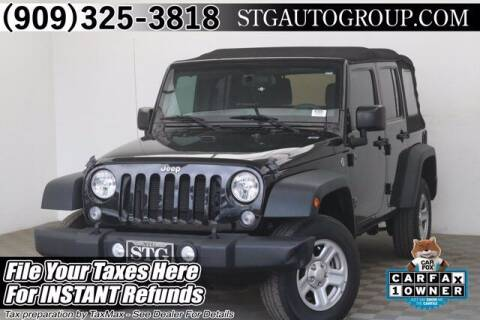 2015 Jeep Wrangler Unlimited for sale at STG Auto Group in Montclair CA
