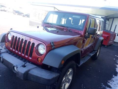 2012 Jeep Wrangler Unlimited for sale at MIRACLE AUTO SALES in Cranston RI