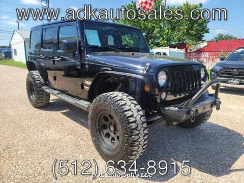 2014 Jeep Wrangler Unlimited for sale at ADK AUTO SALES LLC in Austin TX