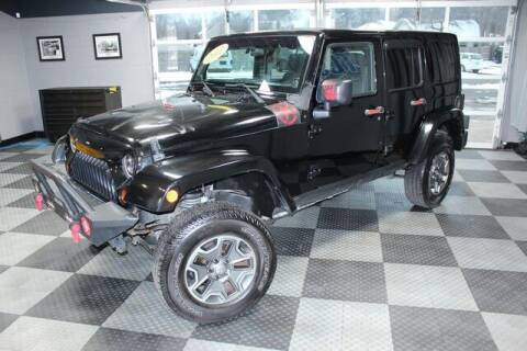 2012 Jeep Wrangler Unlimited for sale at TCC Motors in Farmington Hills MI