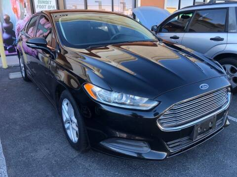 2014 Ford Fusion for sale at LUXE Autos in Las Vegas NV