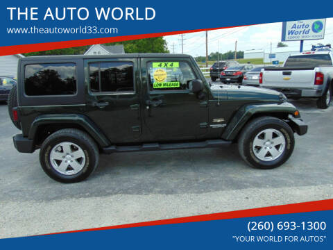 2011 Jeep Wrangler Unlimited for sale at THE AUTO WORLD in Churubusco IN