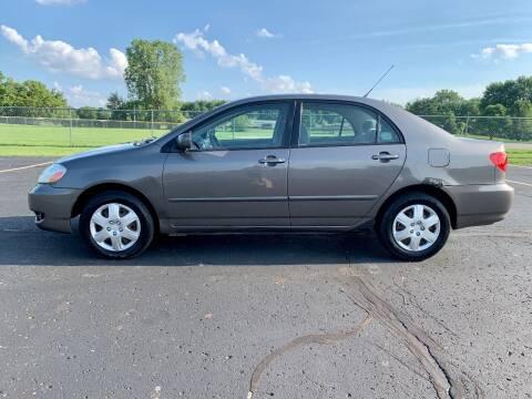 2006 Toyota Corolla for sale at Caruzin Motors in Flint MI