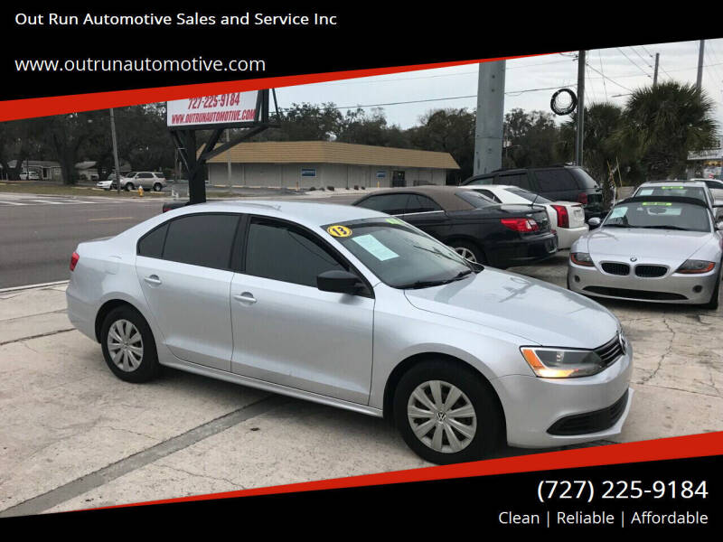 2013 Volkswagen Jetta for sale at Out Run Automotive Sales and Service Inc in Tampa FL