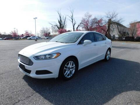 2013 Ford Fusion for sale at AMERICAR INC in Laurel MD