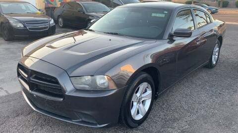 2013 Dodge Charger for sale at 911 AUTO SALES LLC in Glendale AZ