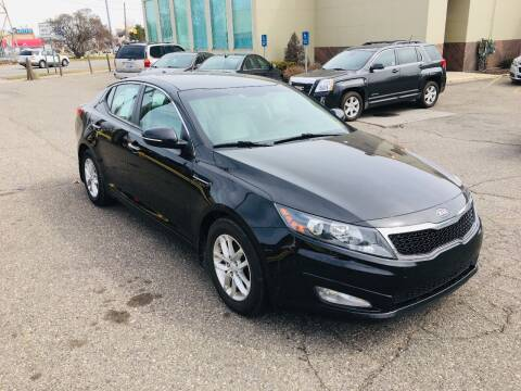 2012 Kia Optima for sale at Big Three Auto Sales Inc. in Detroit MI