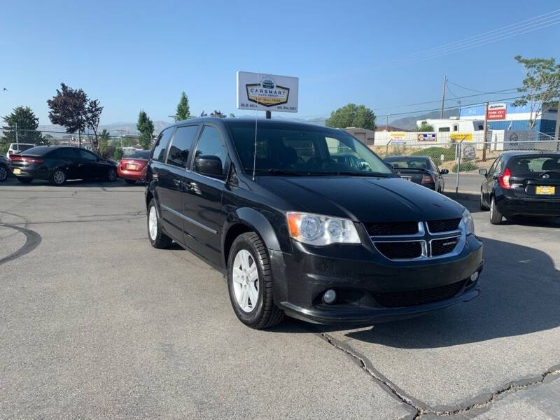 2013 Dodge Grand Caravan for sale at CarSmart Auto Group in Murray UT