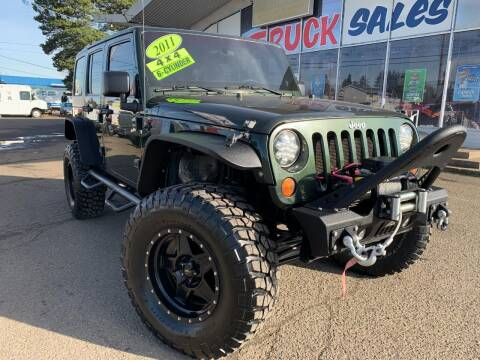 2011 Jeep Wrangler Unlimited for sale at Xtreme Truck Sales in Woodburn OR