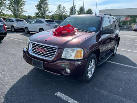 2006 GMC Envoy for sale at Charlotte Auto Group, Inc in Monroe NC