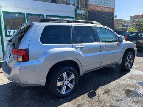 2010 Mitsubishi Endeavor for sale at Barnes Auto Group in Chicago IL