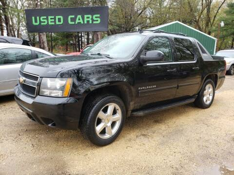 2011 Chevrolet Avalanche for sale at Northwoods Auto & Truck Sales in Machesney Park IL