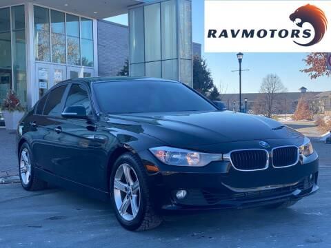 2013 BMW 3 Series for sale at RAVMOTORS in Burnsville MN