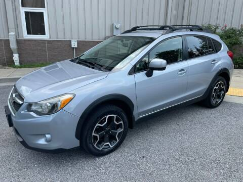 2014 Subaru XV Crosstrek for sale at AMERICAR INC in Laurel MD