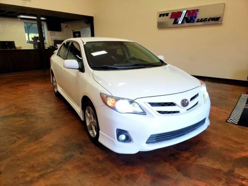 2011 Toyota Corolla for sale at Driveline LLC in Jacksonville FL