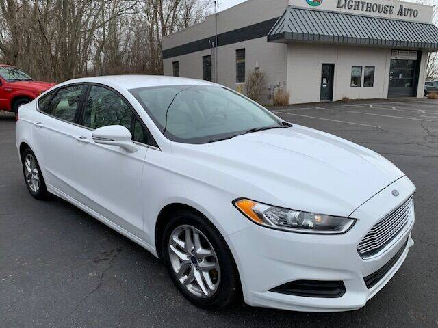 2013 Ford Fusion for sale at Lighthouse Auto Sales in Holland MI