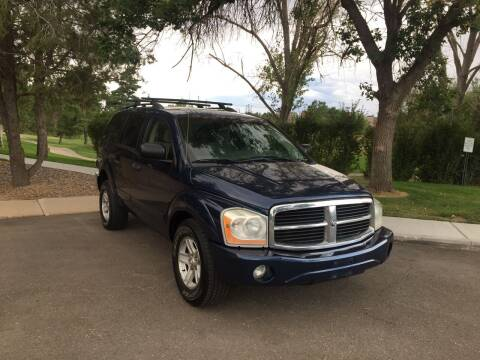 2005 Dodge Durango for sale at QUEST MOTORS in Englewood CO