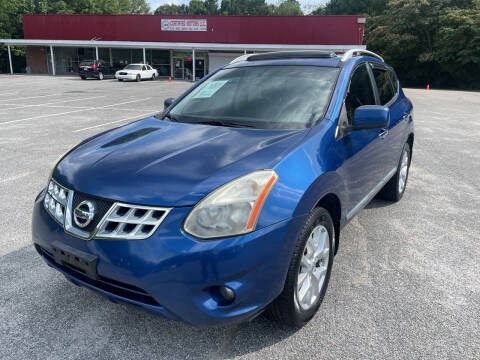 2011 Nissan Rogue for sale at Certified Motors LLC in Mableton GA